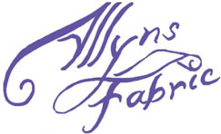 Logo for Allyns Fabric.  Text is purple handwritten printing with a bolt of fabric between words.